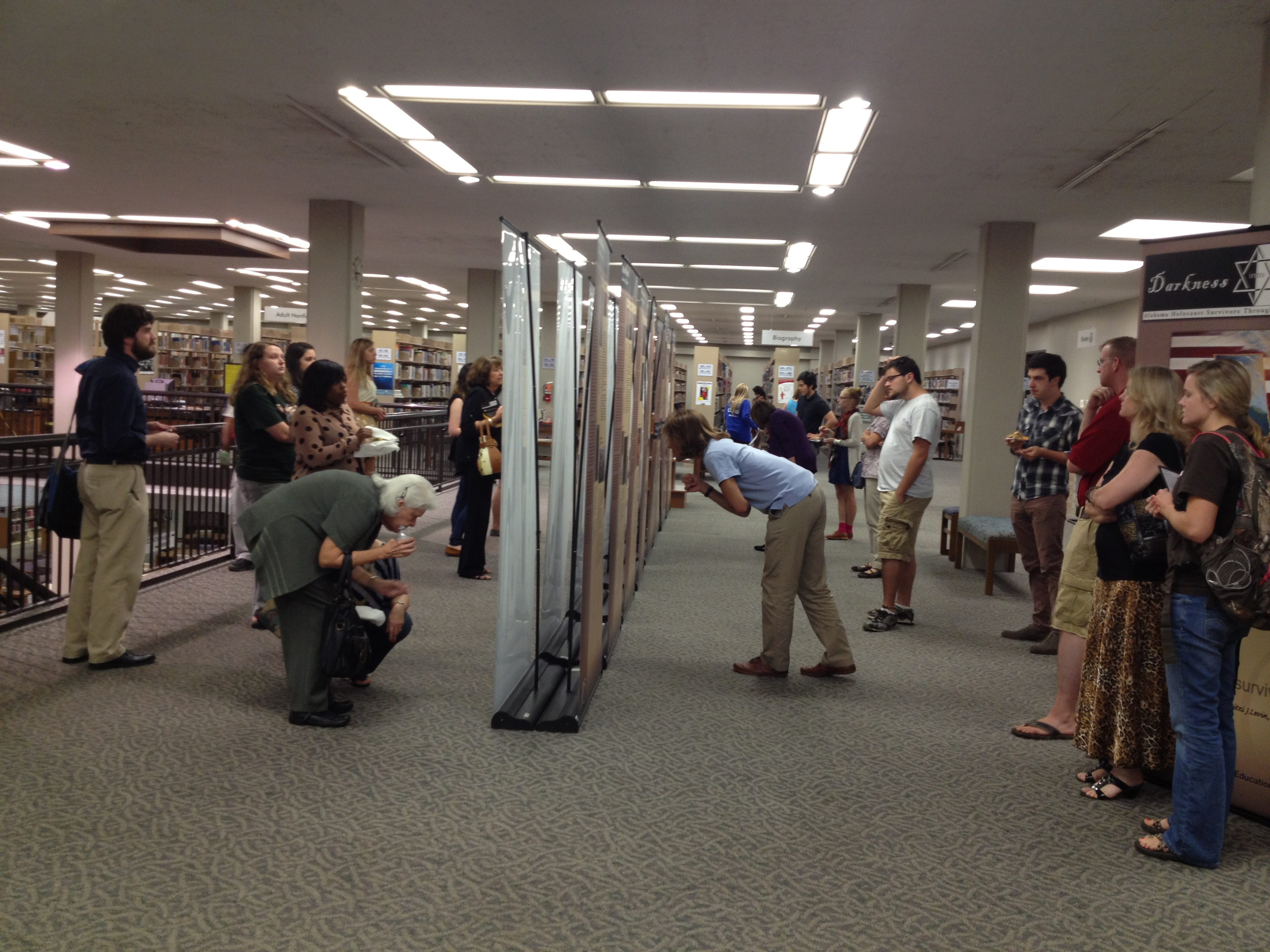 Visitors view the Holocaust Exhibit at the Tuscaloosa Public Library