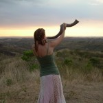 woman blowing shofar